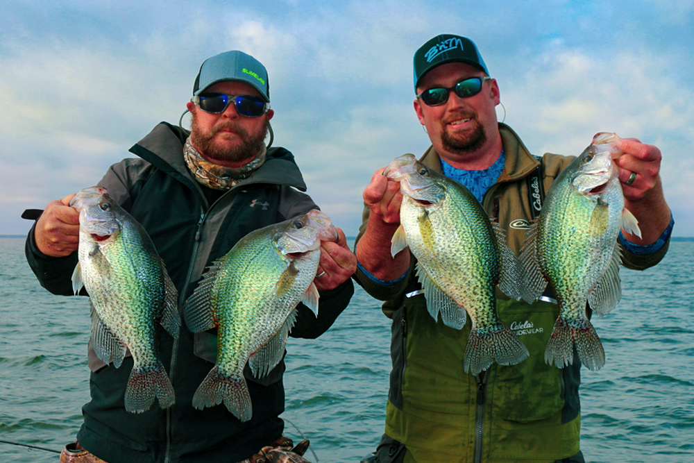Joseph Dennis and Matt Outlaw with some slab crappie caught in Lake Moultrie, spider-rigging 20 feet deep