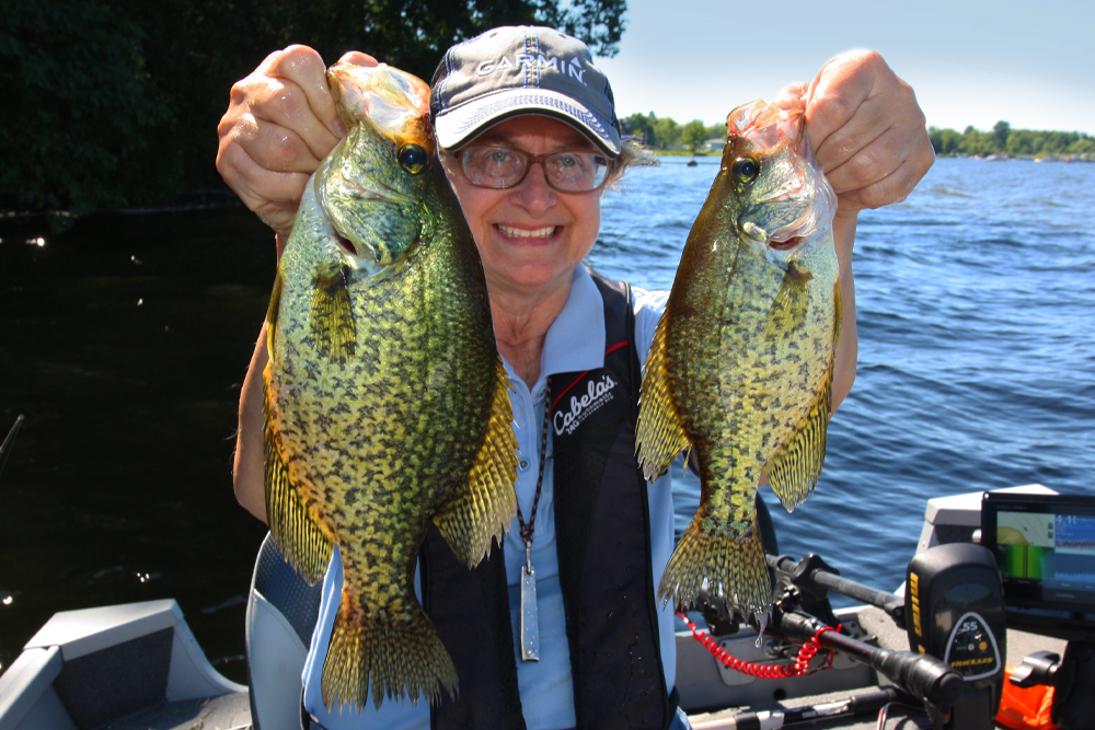 Marilyn Black with a brace of crappies from Conneaut Lake. (Photo: Darl Black)