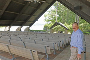 Elmore County Commissioner Mack Daugherty stands in The Church in the Pines that offers outdoor non-denominational services every Sunday. It seats 900 people and the cove can be used for on-the-water attendance by tuning the boat radio to the church channel. (Photo: Tim Huffman)