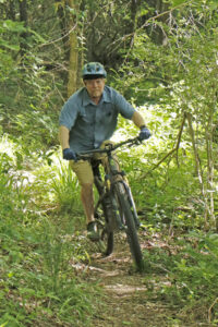 Mountain biker Robbie Broach enjoys the wooded trails at Swayback Bridge Trials. Visitors can hike or bike different trails to enjoy the outdoors in a quiet, peaceful environment. (Photo: Tim Huffman)